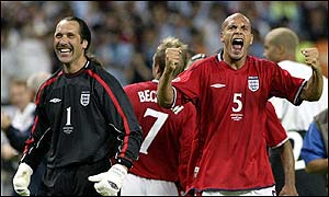 England's David Seaman and Rio Ferdinand celebrate a famous win over Argentina